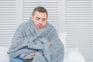 man in blanket image